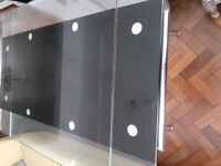 Glass and black top dining table