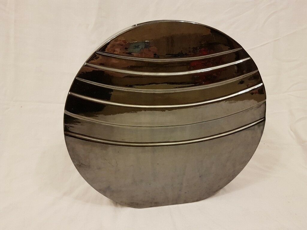 Circular silver/ grey vase