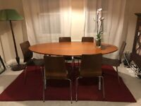 Brown wood/chrome dining table with adjustable legs and six chairs. Good condition.