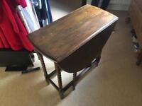 Drop leaf barley twist leg varnished oak table