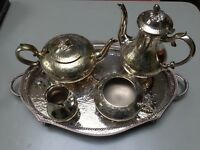 4 piece EPNS tea service on metal tray good condition.