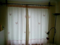 White/pink patterned curtains