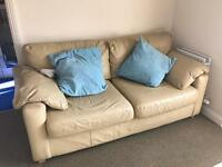 Cream leather sofas 3 and a 2