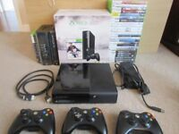 Xbox 360 console, 4 wireless remotes and huge games bundle.