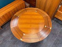 Danish Circular Flip-Flap Lotus Extending Teak Dining Table by Dyrlund. Retro Vintage Mid Century