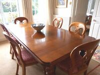 Beautiful Mahogany Dining Table seats 10, 6 matching chairs. Very good condition. Cost £2000 new.