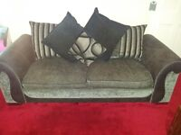 Set of Two three seater sofas,very trendy and great condition.extra covers also