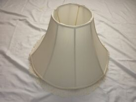 Lamp Shade, Large in size and white in colour.