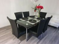 Black Glass Dinning Table Set with 6 Chairs in Excellent Condition Available Now