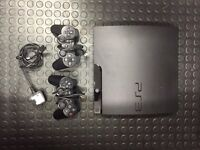 Playstation 3 Slim with 2 controllers.