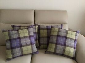 4 heather shades plaid cushions with caramel suedette backs. Size 46cm square.