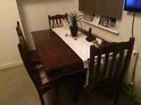 Classic wooden dining table and chairs set