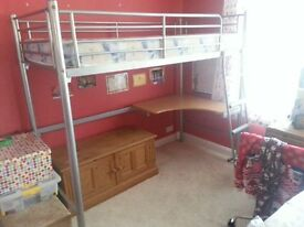 Child's metal cabin bed with desk.