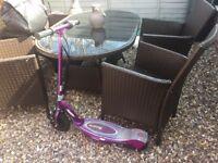 2 Purple Razor Electric Scooters