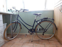 Bobbin Brownie blueberry bike with Bern helmet and lock