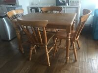Dining Table and Four (4) Chairs