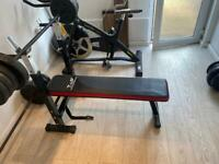 Weights bench, two big bars and two small, over 100kg of weights