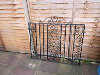 A set of two heavy steel garden gates