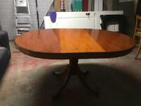 Hardwood extendable dining table with glass cover and 4 chairs