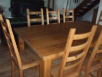 Pine table and 8 chairs