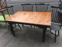 Solid Pine Dining/Kitchen Table with 4 solid pine chairs . The table does not have an extension.