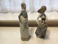 2 Lladro girls figures holding animals retired