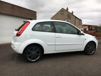 White Ford Fiesta 2008 'Blue Edition'. 1.25 petrol. 3 door. Low mileage 39,753 miles. 10 month MOT.