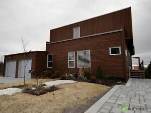 700 000$ - Maison 2 étages à vendre à Chicoutimi