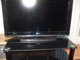 Black glass TV stand, 2 shelves, in excellent condition.