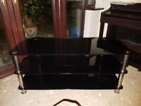 TV Table - Black tempered glass & Chrome legs. Stylish Design. Suitable for up to 55 inch TVs