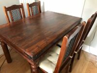 Dining table and four chairs. Maharani - John Lewis