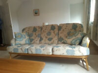 Original Ercol Jubilee Beech three seat sofa, two matching Armchairs.