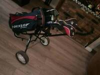 Dunlop golf clubs and bag / trolley etc.
