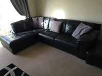 Black leather large corner suite and black swivel chair