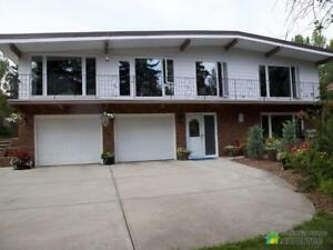 $658,000 - Raised Bungalow for sale in Strathcona County