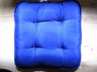 Four garden chair cushions for sale