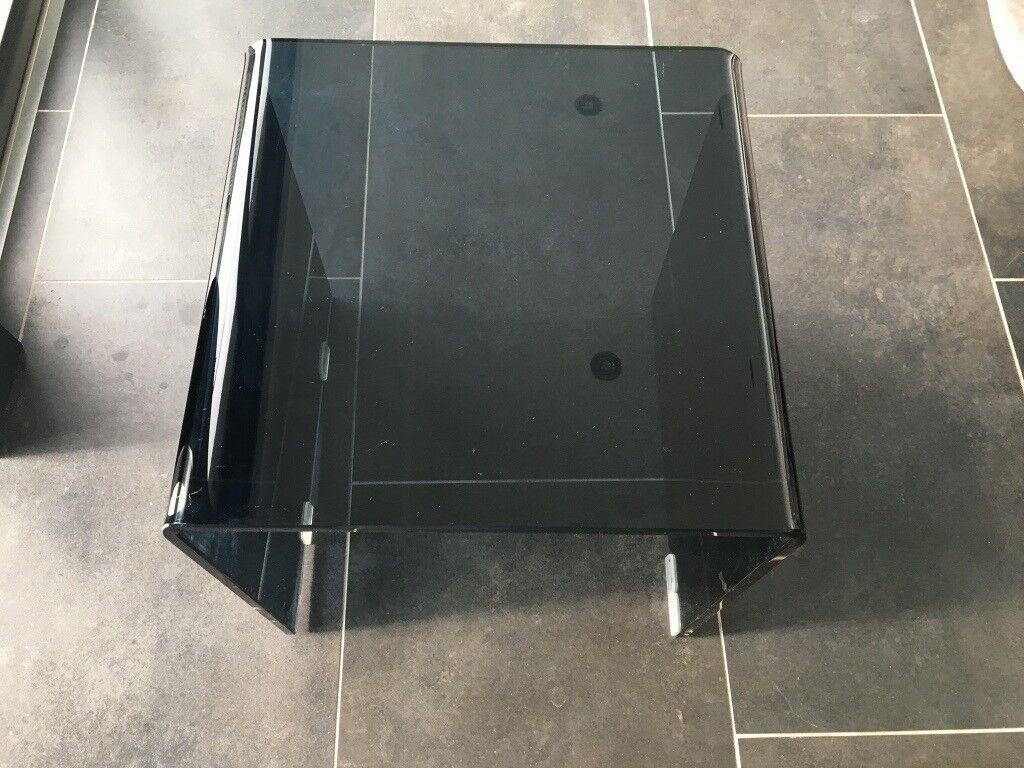 Contemporary black smoked glass table