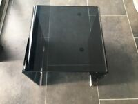 Contemporary black smoked glass table
