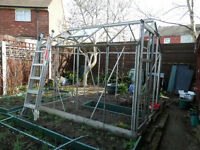 6' X 8' Greenhouse, partially disassembled, only some glass and plastic [due to high winds].