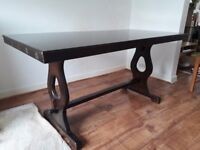 Dining table. Dark wood, Tudor rose engraving, no chairs