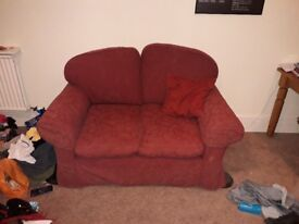 Red two seater sofa for sale