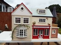 Hand made collect able dolls house with double fronted shop and separate garden room.