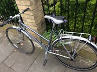 Excellent Raleigh Hybrid bicycle with mudguards Weinmann brakes. TranZ . Campagnolo headset. Bell,