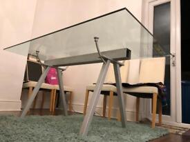 Glass dining room table with industrial style metal legs