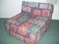 Single sofa bed chair bed - futon style (foam). Ideal for overnight guests. Used as bed or chair