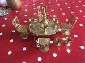 A MINIATURE furniture BRASS TABLE AND FOUR CHAIRS and six goblets and small genie lamp