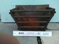 ANTIQUE FIRE GRATE-Approximately 30cm wide.