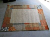 Wool rug....Natural with some colour as shown. Excellent condition. size.. 160 x 120 cm