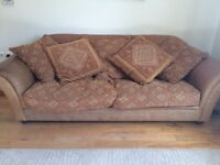 Mid-brown leather and tapestry sofa. Good condition