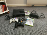 Xbox 360 with Controllers + 2 games.